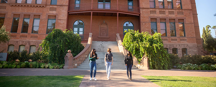 Photo of students interacting outside of ASU's historic Old Main building