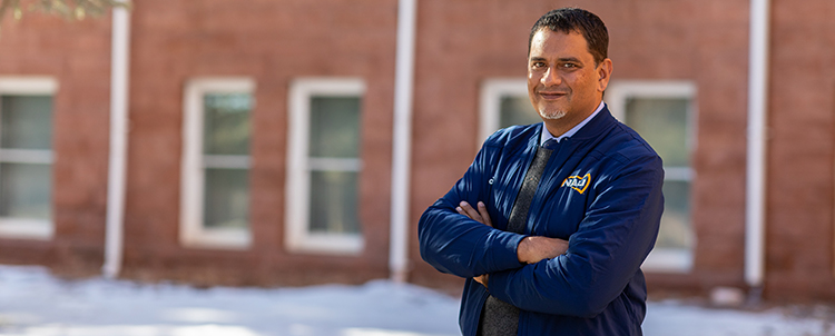 Photo of Dr. Cruz at NAU standing outside
