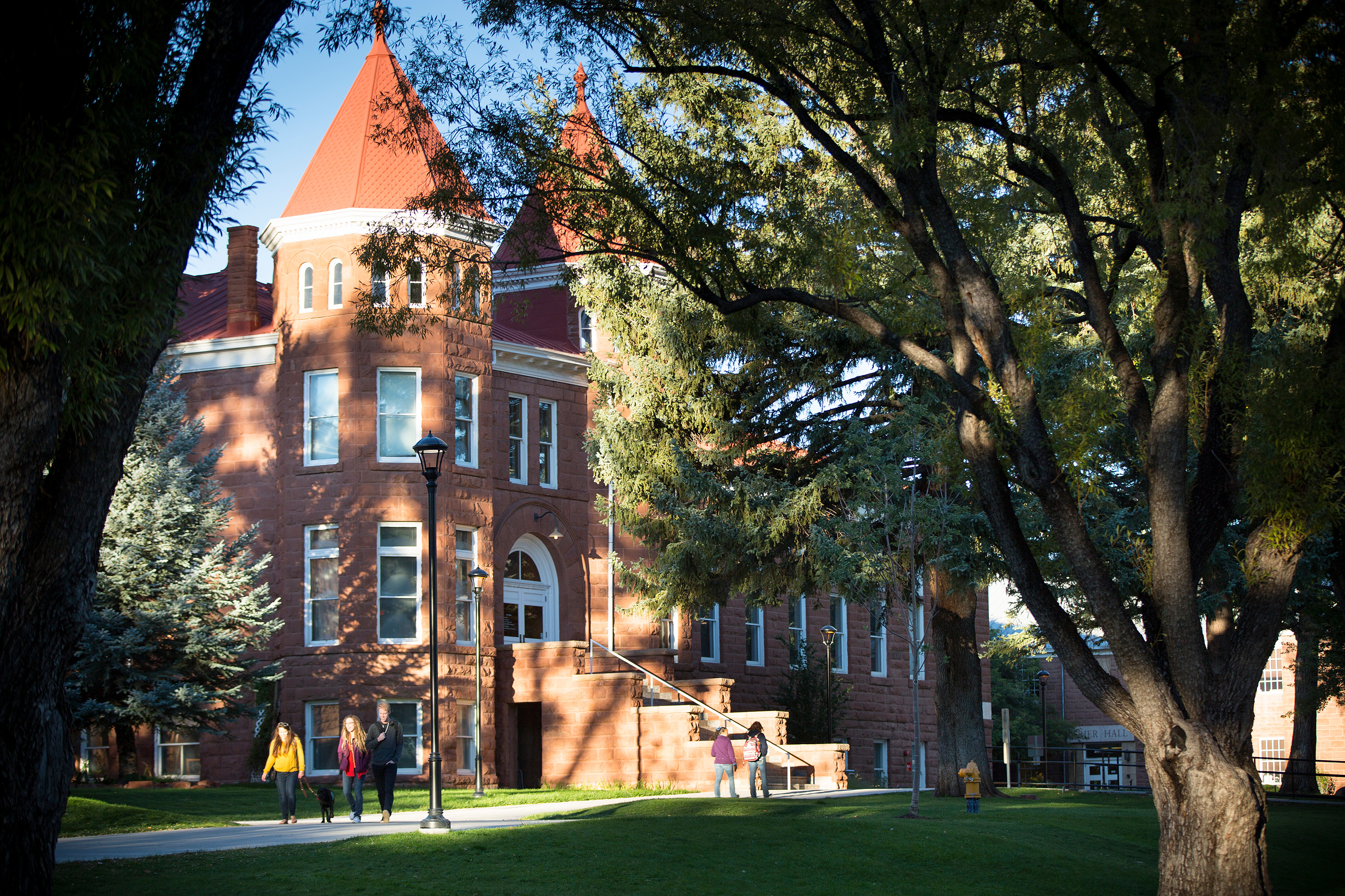 Photo of Old Main on NAU campus with students walking in the foreground