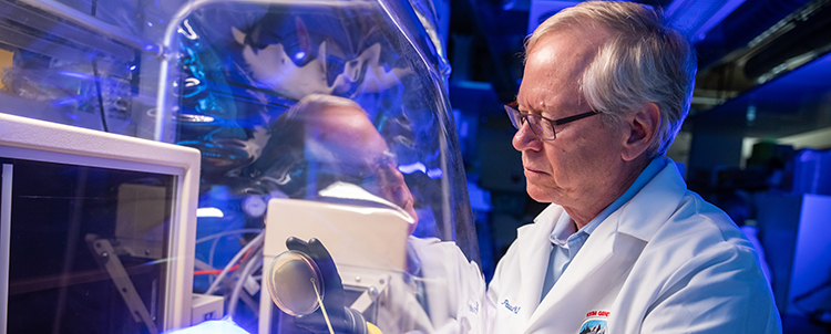 Paul Keim works in his lab.